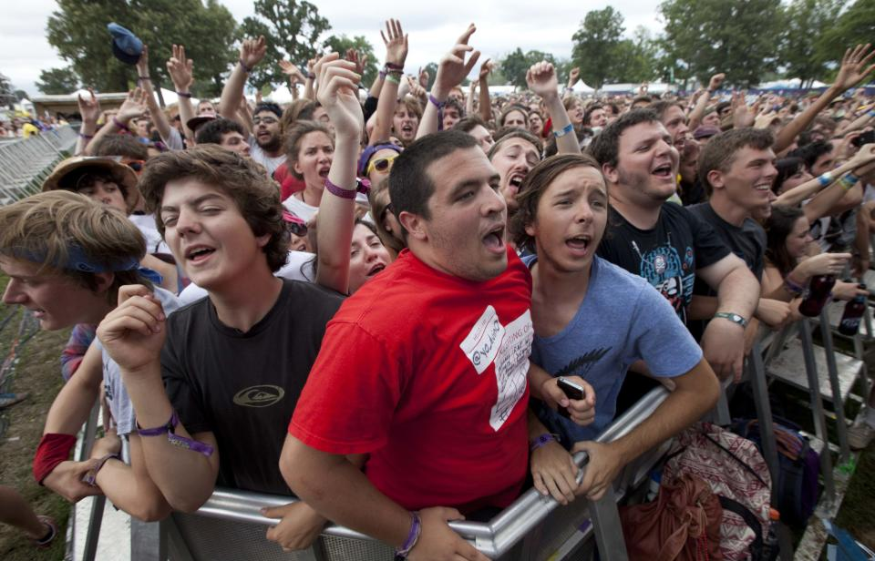 Fans react during a performance by The Black Lips during the Bonnaroo Music and Arts Festival in Manchester, Tenn., Sunday, June 10, 2012. (AP Photo/Dave Martin)