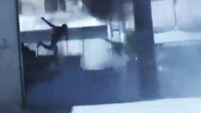 In this image made from amateur video released by the Ugarit News and accessed Monday, July 23, 2012, a Syrian government solider jumps off a military tank that caught on fire during clashes with Free Syrian Army soldiers in Aleppo, Syria. The Syrian regime acknowledged for the first time Monday that it possessed stockpiles of chemical and biological weapons and said it will only use them in case of a foreign attack and never internally against its own citizens. (AP Photo/Ugarit News via AP video) TV OUT, THE ASSOCIATED PRESS CANNOT INDEPENDENTLY VERIFY THE CONTENT, DATE, LOCATION OR AUTHENTICITY OF THIS MATERIAL