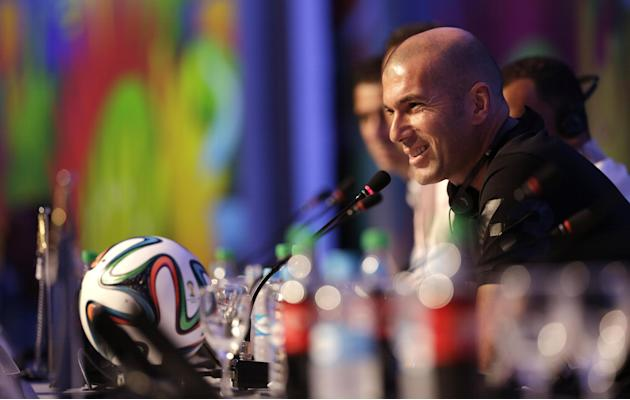 Former soccer great and World Cup winner Zinedine Zidane of France smiles during a press conference one day before the draw for the 2014 soccer World Cup in Costa do Sauipe near Salvador, Brazil, Thur