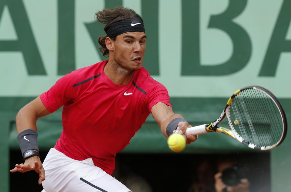 Spain's Rafael Nadal returns the ball to Serbia's Novak Djokovic during their men's final match in the French Open tennis tournament at the Roland Garros stadium in Paris, Monday, June 11, 2012. (AP Photo/Michel Euler)