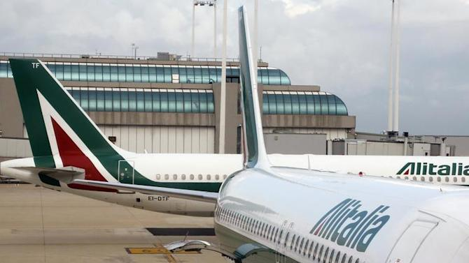 An Alitalia plane is pictured before takeoff at the Fiumicino airport in Rome