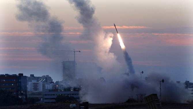 """The Iron Dome defense system fires to interecpt incoming missiles from Gaza in the port town of Ashdod, Thursday, Nov. 15, 2012. Israel's prime minister Benjamin Netanyahu said Thursday  that the army is prepared for a """"significant widening"""" of its operation in the Gaza Strip. (AP Photo /Tsafrir Abayov)"""