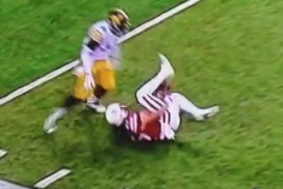 Falling Nebraska WR shuffles ball through his legs, catches it anyway