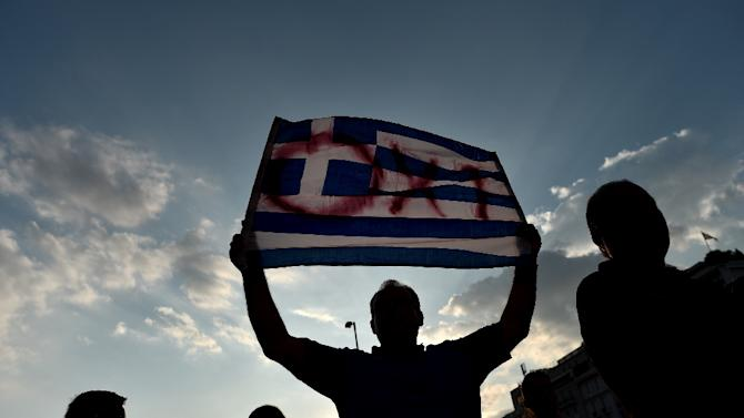"""Protesters participate in a demonstration calling for a """"No"""" vote in the referendum on bailout conditions set by the country's creditors, in front of the Greek parliament in Athens on June 29, 2015"""