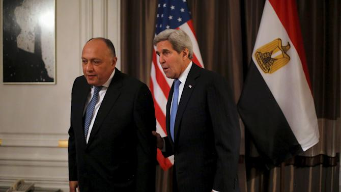 Egyptian Foreign Minister Sameh Shoukry and U.S. Secretary of State John Kerry listen to a reporter's question as they take their seats for a bilateral meeting at Kerry's hotel in Paris