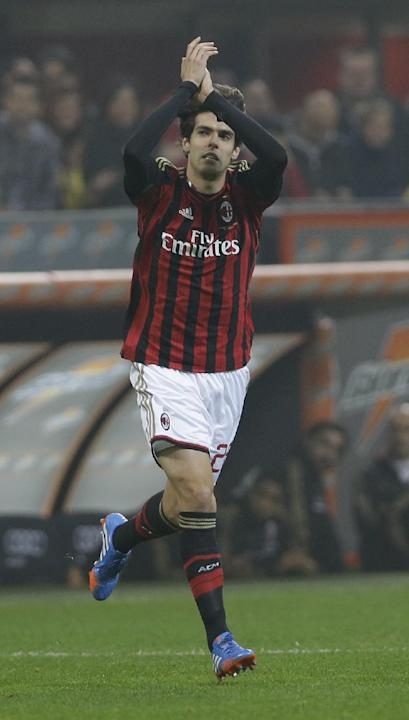 AC Milan Brazilian forward Ricardo Kaka', waves to spectators as he enters the pitch during a Serie A soccer match between AC Milan and Udinese, at the San Siro stadium in Milan, Italy, Saturday, Oct.