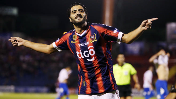 Guiza of Cerro Porteno celebrates scoring a goal against Nacional during their Paraguayan first division soccer match in Asuncion