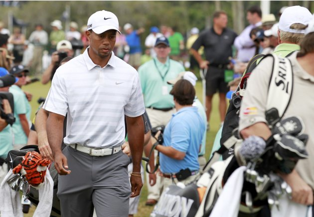Tiger Woods of the U.S heads to the first tee during third round play in the 2013 WGC-Cadillac Championship PGA golf tournament in Doral