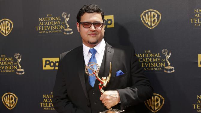 """Executive producer Martin poses on the red carpet with his Outstanding New Approaches - Drama Series Award for """"The Bay"""" at the 42nd Annual Daytime Emmy Awards in Burbank"""