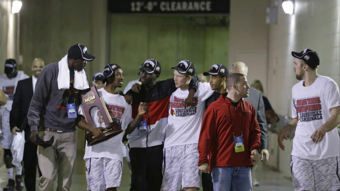 Louisville players walk to their locker room following the trophy presentation after their 85-63 win over Duke in the Midwest Regional final in the NCAA college basketball tournament, Sunday, March 31, 2013, in Indianapolis. (AP Photo/Darron Cummings)