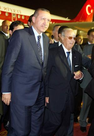 In this Sept. 14, 2011, photo, Tunisian Prime Minister Beji Caid Essebsi, right, greets his Turkish counterpart Recep Tayyip Erdogan , left, at the Tunis-Carthage airport, Tunisia. (AP Photo/Amine Landoulsi)