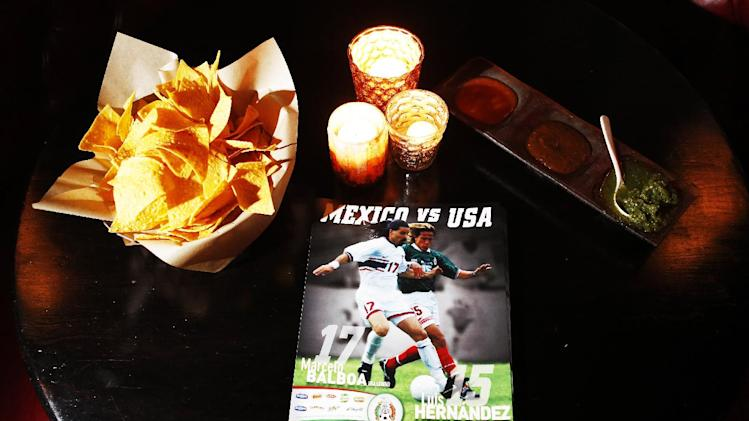 Mexico versus USA fliers rest on a table during the Unilever launch of the Tu Seleccion campaign, on Tuesday, March 26, 2013, in New York. (John Minchillo/AP Images for Unilever)
