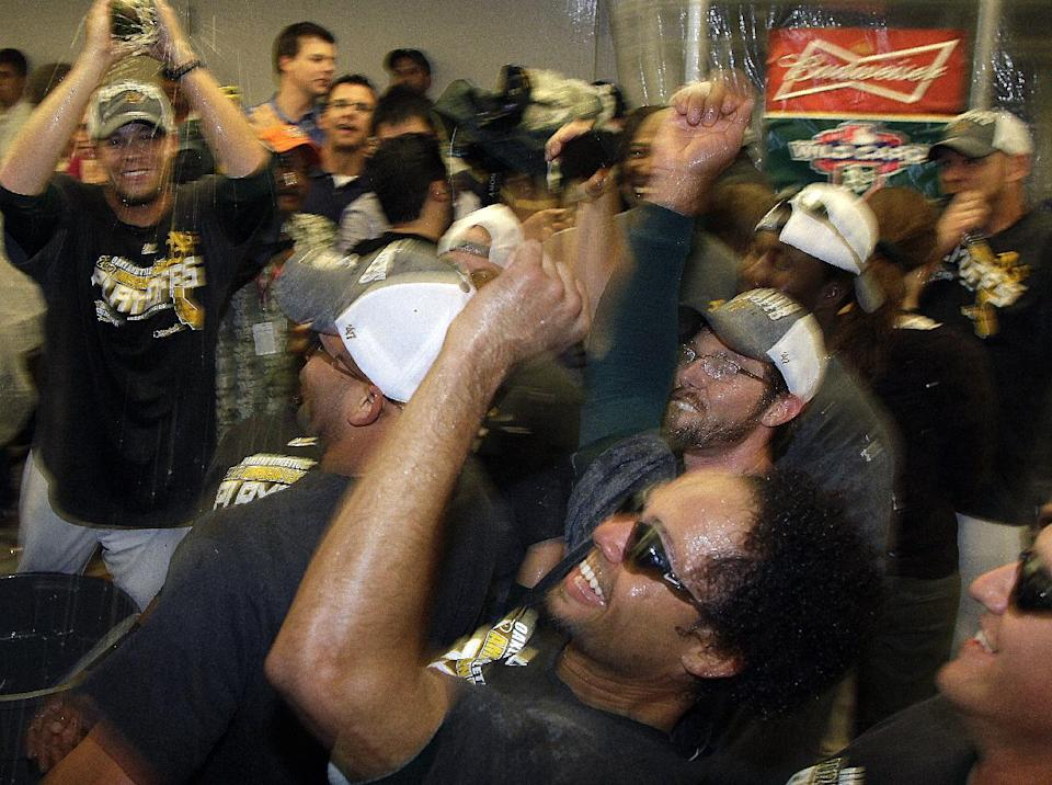 "Oakland Athletics players, including Coco Crisp, bottom center, do the ""Bernie"" dance in the locker room as they celebrate after clinching a wild card berth in the American League at the end of a baseball game against the Texas Rangers Monday, Oct. 1, 2012, in Oakland, Calif. (AP Photo/Ben Margot)"