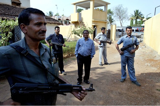 FILE – In this April 15, 2007 file photo, Mahendra Karma, center, lawmaker and founder of Salwa Judum, the government-supported militia to combat Communist rebels known as Naxalites, is surrounded by