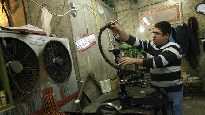 A man works at a shisha manufacturing factory in Baghdad