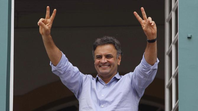Brazil's presidential candidate Aecio Neves of the Brazilian Social Democratic Party (PSDB) gestures to supporters in Sao Joao del Rei