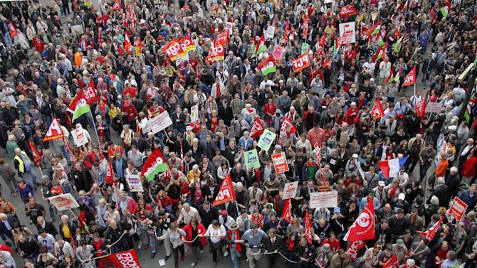 Demonstrators walk during a rally to protest against the austerity measures announced by the French government, in Paris, Sunday, May 5, 2012. (AP Photo/Michel Spingler)