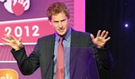 <p>Prince Harry speaks at the WellChild awards ceremony in London on September 3, 2012. Prince Harry made light of his recent exploits in his first public appearance since naked photographs of him in a Las Vegas hotel room surfaced on the internet.</p>