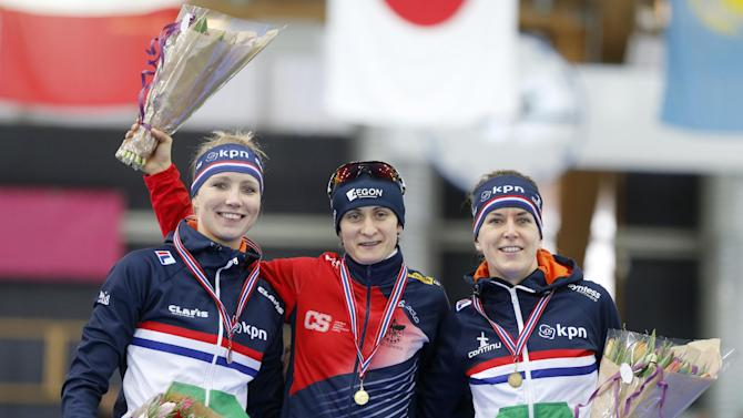 From left to right: Second placed Carlijn Achtereekte of Netherlands, winner Martina Sablikova of Czech Republic and third placed Ireen Wüst of Netherlands at the podium after  the women's 3000 meter during the Speed Skating World Cup at the Viking Ship ice skating arena in Hamar, Norway, Sunday, Feb. 1, 2015. (AP Photo/NTB Scanpix, Terje Pedersen)