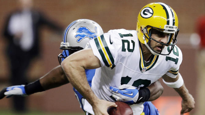 Detroit Lions defensive tackle Nick Fairley, rear, causes Green Bay Packers quarterback Aaron Rodgers (12) to fumble in the third quarter of their NFL football game in Detroit, Sunday, Nov. 18, 2012. Detroit recovered the ball. (AP Photo/Paul Sancya)