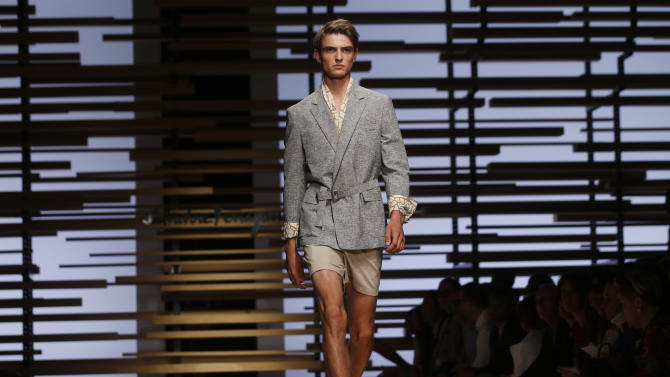 A model wears a creation for Salvatore Ferragamo men's Spring-Summer 2015 collection, part of the Milan Fashion Week, unveiled in Milan, Italy, Sunday, June 22, 2014. (AP Photo/Luca Bruno)
