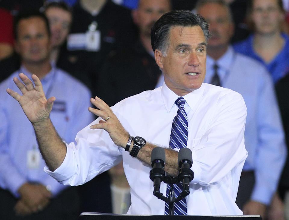 Republican presidential candidate, former Massachusetts Gov. Mitt Romney gestures while speaking during a campaign stop at Jet Machine, Thursday, Oct. 25, 2012, in Cincinnati. The company is a defense contractor. (AP Photo/Al Behrman)
