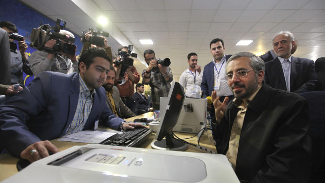 Former Iranian health minister Kamran Bagheri Lankarani, right, registers his candidacy for upcoming presidential election, at the interior ministry, in Tehran, Iran, Tuesday, May 7, 2013. Iranian authorities opened the registration process Tuesday for candidates in next month's presidential election that will pick a successor to President Mahmoud Ahmadinejad and offer a critical test for reformists battered after years of crackdowns.(AP Photo/Vahid Salemi)