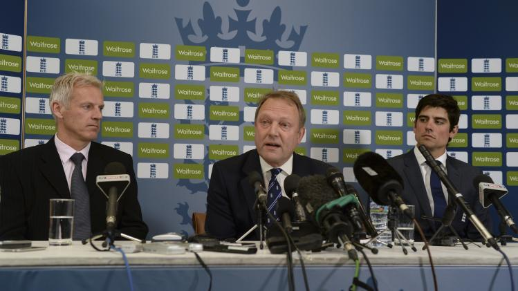 England's Moores sits with Downton and Cook during a press conference in which it was confirmed Moores will be the new head coach of the England cricket team at Lord's cricket ground in London