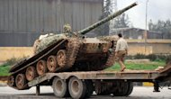 Syrian rebels deploy a Soviet-made T-55 tank in the Qadi Askar district of Aleppo on February 8, 2013. President Bashar al-Assad has reshuffled his cabinet as regime warplanes raided rebel areas in a bid to end the stalemate in Syria's deadly civil war and hopes for a political solution appeared to founder