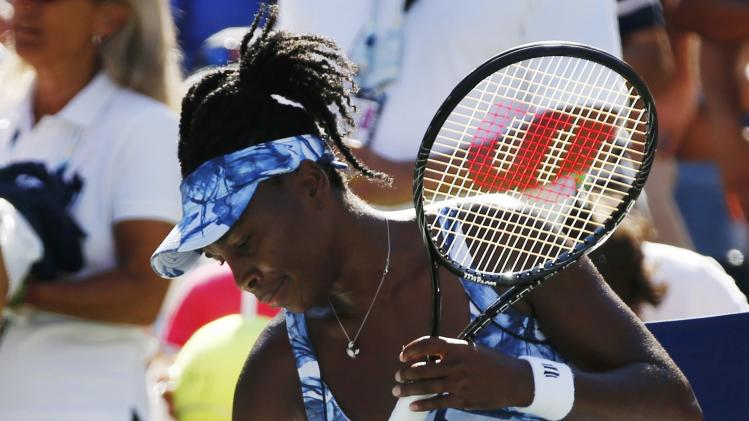 Venus Williams of the U.S. packs up after her loss to Sara Errani of Italy at the 2014 U.S. Open tennis tournament in New York