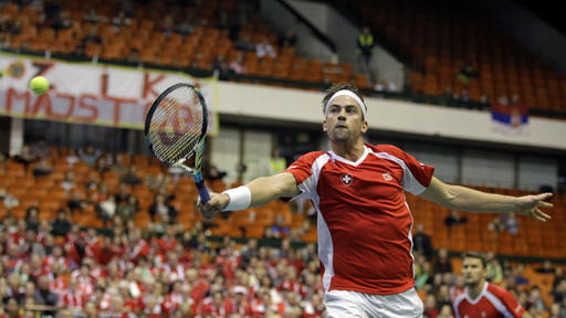 Switzerland advances in Davis Cup, beats Serbia