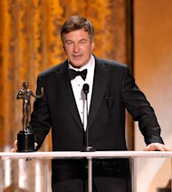 Alec Baldwin accepts the award for outstanding male actor in a comedy series for 30 Rock at the 19th Annual Screen Actors Guild Awards at the Shrine Auditorium in Los Angeles on Sunday Jan. 27, 2013. (Photo by John Shearer/Invision/AP)