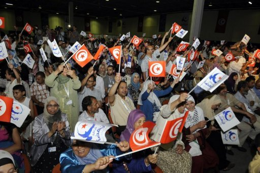 Ennahda party members cheer after the re-election of party founder Rached Ghannouchi as party leader in July 2012 in Tunis. Ennahda on Wednesday filed a bill that would prohibit blasphemy, said Habib Khedher, who heads the committee in charge of drafting the constitution