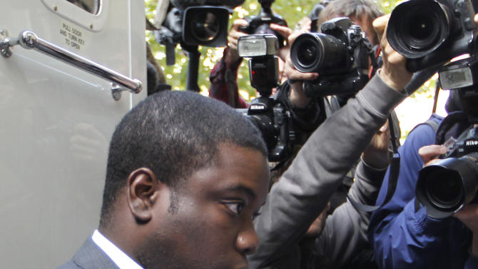 FILE- City trader Kweku Adoboli, arrives at Court in London in this file photo dated Thursday Sept. 22, 2011,  where he is accused of fraud and false accounting at Swiss banking giant UBS. Adoboli broke down in tears as he took the stand for the first time Friday Oct. 26, 2012, as he insisted he had acted purely to help save the bank he considered his family. Adoboli has pleaded not guilty to all charges against him. (AP Photo/Sang Tan, File)
