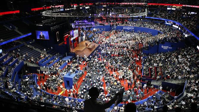 Delegates gather in the Tampa Bay Times Forum during the Republican National Convention in Tampa, Fla., on Tuesday, Aug. 28, 2012. (AP Photo/Jae C. Hong)
