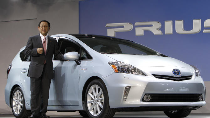 Akio Toyoda, President, Toyota Motor Corporation introduces the Prius V midsize hybrid-electric vehicle at the North American International Auto Show in Detroit, Monday, Jan. 10, 2011.  (AP Photo/Paul Sancya)