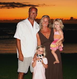 """In this February 2011 photo provided by the Barnett family, Corey Carlson, left, and his family are shown during a month long vacation in Kolenea, Hawaii. The family was killed Saturday, July 30, 2011, after their float plane was involved in a mid-air collision about 80 miles north of Anchorage, Alaska. Shown in the picture are Corey Carlson, his wife, Hetty Barnett Carlson, center, and their daughters, Ella, 5, standing, and Adelaide """"Addie,"""" 3. National Transportation Safety Board investigator Larry Lewis says the private aircraft in each collision were difficult to spot amid mountainous backgrounds. (AP Photo/Courtesy of Barnett family)"""