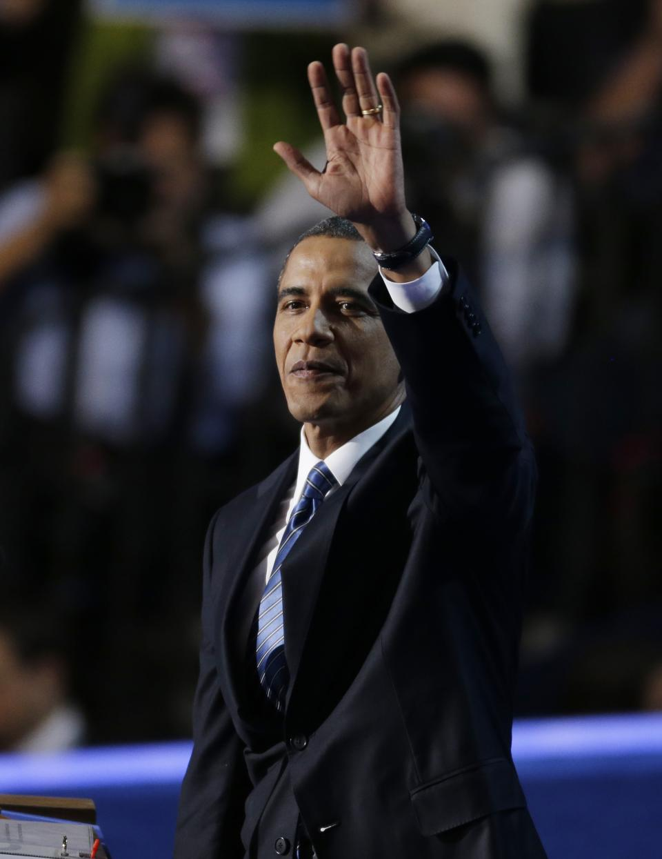 President Barack Obama waves to candidates at the Democratic National Convention in Charlotte, N.C., on Thursday, Sept. 6, 2012. (AP Photo/Lynne Sladky)