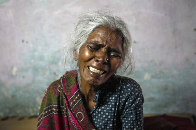 Ram Bai, mother of Ram Singh, the driver of the bus in which a young woman was gang-raped and fatally injured three months ago, wails inside her house in New Delhi