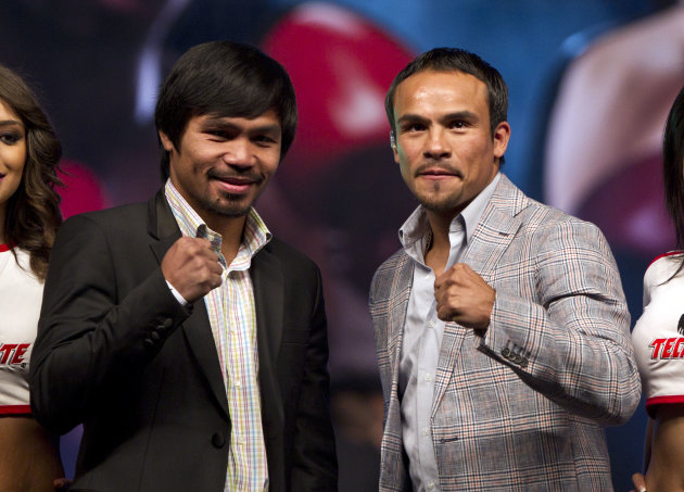 WBO welterweight champion boxer Manny Pacquiao, of the Philippines, left, poses for photos next to his challenger Juan Manuel Marquez, of Mexico, during a news conference in Mexico City, Friday, Sept. 21, 2012. The boxers are promoting their fourth fight, scheduled for Dec. 8, 2012 in Las Vegas. (AP Photo/Christian Palma)