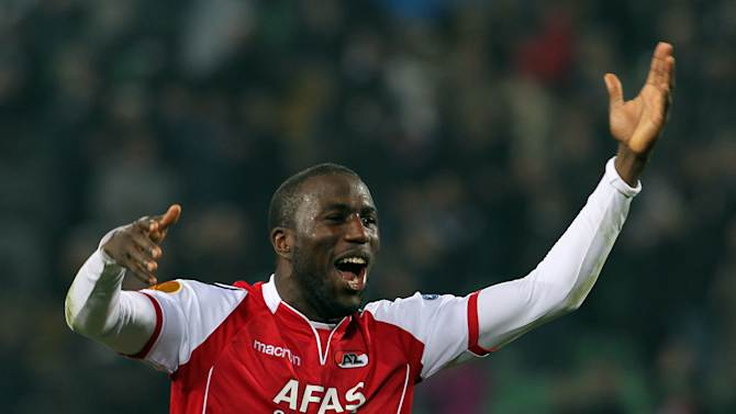 """FILE - In this Thursday, March 15, 2012 file photo AZ Alkmaar's Jozy Altidore, of the United States, celebrates at the end of the Europa League, round of 16, second leg soccer match against Udinese at the Udine Friuli stadium, Italy. Dutch club FC Den Bosch is vowing to do all it can to identify and punish a group of fans who hurled racist abuse at AZ Alkmaar and United States striker Jozy Altidore during a cup quarterfinal. Den Bosch said Wednesday Jan. 30, 2012, that fans responsible for the monkey chants in the KNVB Cup tie """"do not belong in the De Vliert (stadium) and will face the toughest possible sanctions."""" (AP Photo/Paolo Giovannini, File)"""