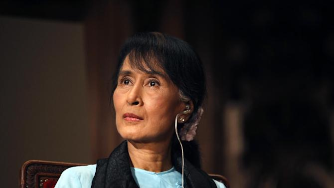 FILE - In a June 28, 2012 file photo, Myanmar opposition leader Aung San Suu Kyi is seen at the Sorbonne University in Paris. The rare Washington consensus behind Obama administration policy toward Myanmar is showing signs of cracks as American businesses grow impatient to invest there and human rights groups push back. Those fissures are becoming evident as the U.S. rolls back its long diplomatic isolation of the military-dominated nation also known as Burma and looks to ease economic sanctions following democratic reforms there.  (AP Photo/Thibault Camus, File)