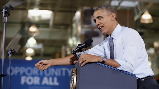 President Barack Obama speaks about raising the minimum wage during a visit to a Costco store in Lanham, Md.,, Wednesday, Jan. 29, 2014. The president is promoting his newly unveiled plans to boost wages for some workers and help Americans save for retirement _ no action from Congress necessary. (AP Photo/Charles Dharapak)