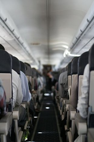 3. You think no one's sitting next to you on an airplane when, lo and behold, someone shows up at the very last second.