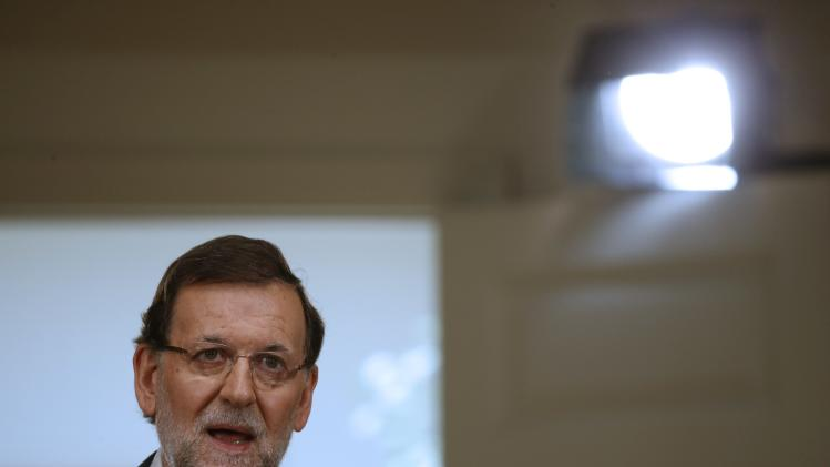 Spain's Prime Minister Rajoy talks during a news conference after his last cabinet meeting at Moncloa palace in Madrid
