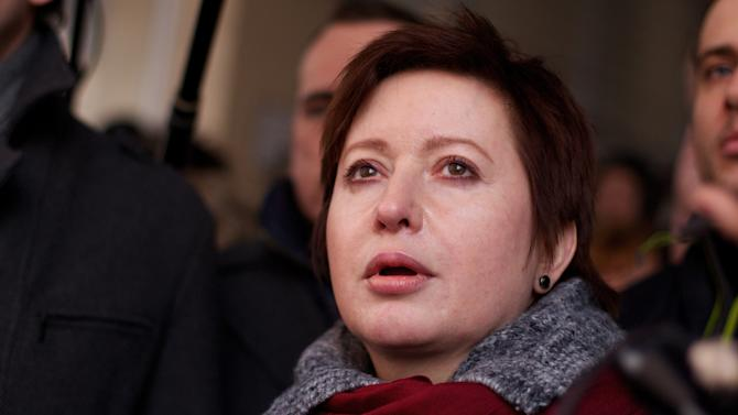 Olga Romanova, a Russian journalist and opposition activist, in the court  during a trial of her husband businessman Alexei Kozlov in Moscow, Thursday, March 15, 2012. Alexei Kozlov, the husband of prominent journalist Olga Romanova, had spent two years in jail after being convicted of fraud. He was released in September after the Supreme Court overturned the verdict, but his case is retried. A Russian court sentenced Kozlov to five years in prison on Thursday in a case that has been embraced by anti-Kremlin protesters.  (AP Photo/Ivan Sekretarev)