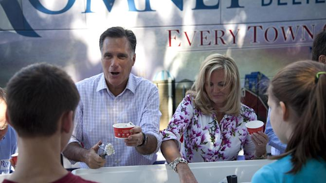 Republican presidential candidate, former Massachusetts Gov. Mitt Romney, and his wife Ann, serve ice cream to supporters during a campaign stop in Milford, N.H., Friday, June 15, 2012.  (AP Photo/Evan Vucci)