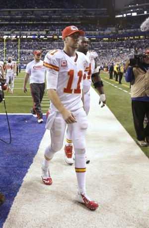 Kansas City Chiefs quarterback Alex Smith (11) leaves the field after an NFL wild-card playoff football game against the Indianapolis Colts Saturday, Jan. 4, 2014, in Indianapolis. Indianapolis defeated Kansas City 45-44. (AP Photo/AJ Mast)