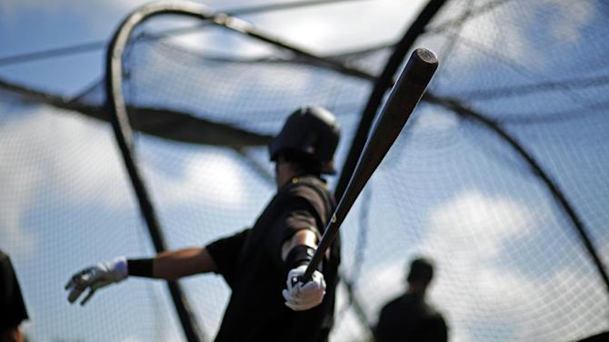 Pittsburgh Pirates' Sean Rodriguez waits his turn in the batting cage before an intrasquad spring training baseball game in Bradenton, Fla., Monday, March 2, 2015. Rodriguez did not play in the game. (AP Photo/Gene J. Puskar)