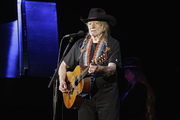 FILE - In this Sunday, Jan. 29, 2012 file photo, country music icon Willie Nelson performs during a fundraising concert for U.S. Rep. Dennis Kucinich in Lorain, Ohio. Willie Nelson, Jamey Johnson, Band of Horses and actor-musician John Reilly and Friends, are all on board for this year&#39;s Railroad Revival Tour. The train tour kicks-off Oct. 20 in Duluth, Ga., and runs through Oct. 28 in Oakland, Calif. (AP Photo/Mark Duncan, File)